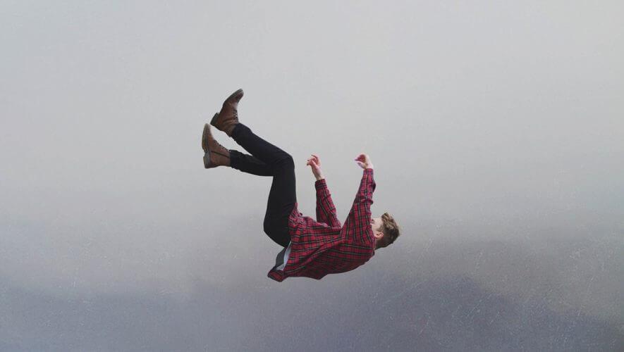 A man in a plaid shirt falling
